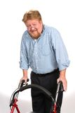 Happy Disabled Man Using Walker. Happy and smiling disabled man uses a walker to maintain his balance stock photos
