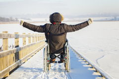 Happy disabled man on wheelchair. In winter day stock photo
