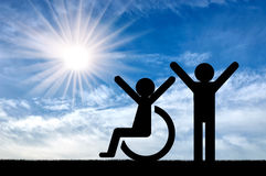 Happy disabled person next to a healthy person. Concept of care and support stock photo