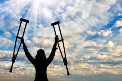 Happy disabled person with raised hands crutches Royalty Free Stock Photos