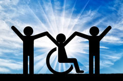 Happy disabled person in a wheelchair together with healthy people. Concept of support and assistance royalty free stock photos