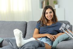 Happy disabled woman posing looking at camera. Sitting on a couch in the living room at home Stock Images