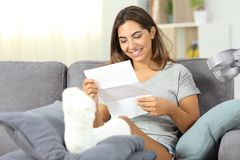 Happy disabled woman reaidng a letter stock images