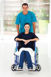 Diabled woman husband. Happy disabled women and her caring husband at home Stock Photography