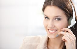 Happy dispatcher working in call center. Using headset, smiling Royalty Free Stock Photography
