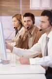 Happy dispatcher working in call center smiling Royalty Free Stock Photography