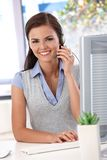 Happy dispatcher working at desk royalty free stock photography