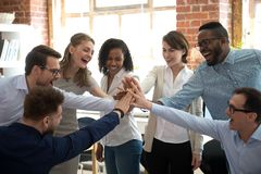 Happy diverse colleagues give high five together celebrate great teamwork. Happy diverse colleagues team people give high five together celebrate great teamwork royalty free stock photography