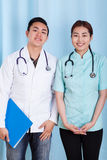 Happy diverse doctors in the office Stock Images