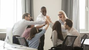 Free Happy Diverse Employees Business Team Engaged In Teambuilding Giving High-five Royalty Free Stock Photo - 141680555