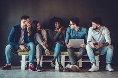 Free Happy Diverse Friends Group Sharing Social Media App News Sitting Holding Phones, Smiling Multiracial Young People Students Royalty Free Stock Photo - 159874405