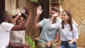 Happy diverse friends students giving high five celebrating multi-ethnic friendship stock footage