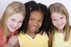 Happy diverse group of little girls. Diverse group of girls  on white Royalty Free Stock Photography