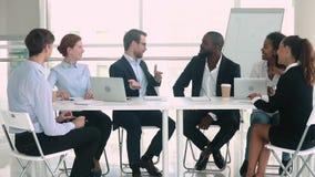 Happy diverse partners establish international partnership handshaking at group negotiations stock video