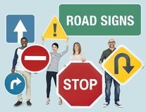 Happy diverse people holding road signs stock photo