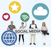Happy diverse people holding social media icons royalty free stock photo