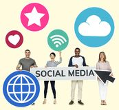 Happy diverse people holding social media icons royalty free stock image