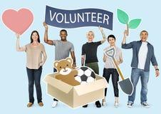 Happy diverse people holding volunteer banner stock image
