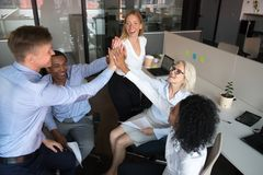 Happy diverse team workers group of businesspeople give high five. Happy diverse team workers group of business people give high five, mentor coach and employees royalty free stock photography