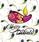 Happy Diwali, burning diya. Elegant card design of traditional Indian festival Diwali with peacock feathers Stock Images