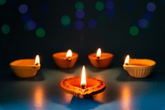 Happy Diwali - Clay Diya lamps lit during Dipavali. Hindu festival of lights celebration royalty free stock images
