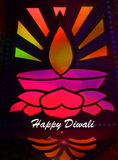 Happy Diwali. A design of traditional Diwali lamp pattern lit colorfully by backdrop for wishes of Diwali festival Royalty Free Stock Photos