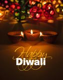 Happy diwali - diwali greeting card with illuminated diya Stock Images