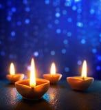 Happy Diwali. Diya lamps lit during diwali celebration Stock Photo