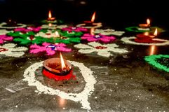 Happy Diwali. Diya Oil Lamps of DIPAWALI celebration decorated over Handmade Rangoli royalty free stock images