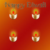 Happy Diwali. With four lighted lamps Royalty Free Stock Photos