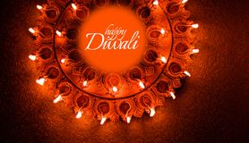 Happy Diwali greeting card design using Beautiful Clay diya lamps lit on diwali night Celebration. Indian Hindu Light Festival ca Stock Photo