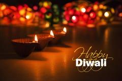 Happy diwali - diwali greeting card with illuminated diya. Stock photo of diwali greeting card showing illuminated diya or oil lamp or panti with Happy Diwali