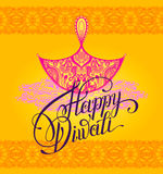Happy Diwali greeting card with paisley ornamental candle and ha. Nd written inscription to indian  fire  community festival, vector illustration Royalty Free Stock Photo