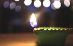 Realistic Diwali lamp with flame. Realistic shining candle stock photo