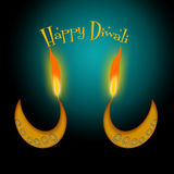 Happy Diwali. Two Diwali lamps on teal background Royalty Free Stock Photography