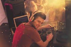 Happy dj with mixer Royalty Free Stock Image