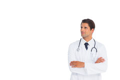 Happy doctor with arms crossed looking up Royalty Free Stock Photo
