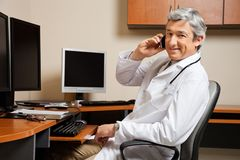 Happy Doctor On Call Stock Images