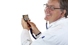 Happy doctor checks harddisk with stethoscope Stock Photos