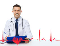 Happy doctor with clipboard and cardiogram pattern Stock Image