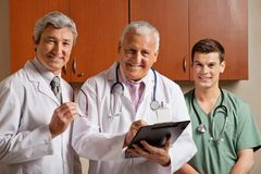 Happy Doctor With Colleagues Royalty Free Stock Images