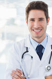 Happy doctor crossed his arms looking at camera Royalty Free Stock Photo