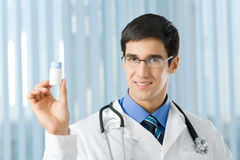 Happy doctor with drug Royalty Free Stock Image
