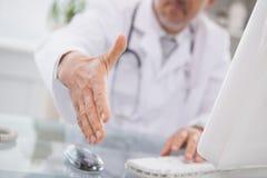 Happy doctor handshake at his patient Stock Image