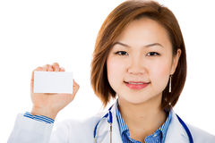 A happy doctor is holding a blank business card. Stock Photos
