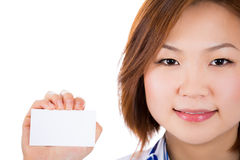 A happy doctor is holding a blank business card. Royalty Free Stock Photo