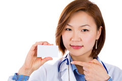 A happy doctor is holding a blank business card. Stock Image