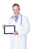 Happy Doctor Holding Blank Digital Tablet Royalty Free Stock Image
