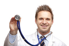 Happy doctor holding stethoscope for examination Stock Image