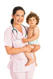 Happy doctor holding toddler boy Royalty Free Stock Photos